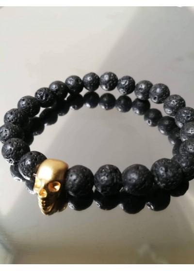 Мъжка гривна от Lava Stone с череп в златисто