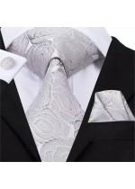Елегантен комплект вратовръзка кърпичка и ръкавели с флорални мотиви в сребристо сиво